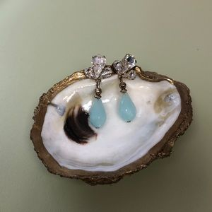 Dangly earring with CZ up top and a blue stone